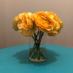 Artificial yellow flowers in vase